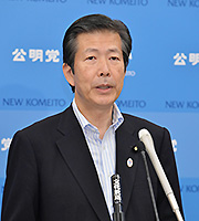 Yamaguchi spoke to the press on the cabinet decision on July 1, 2014