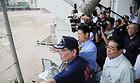 加茂谷中学校で浸水被害の説明を聞く石田氏ら=12日 徳島・阿南市